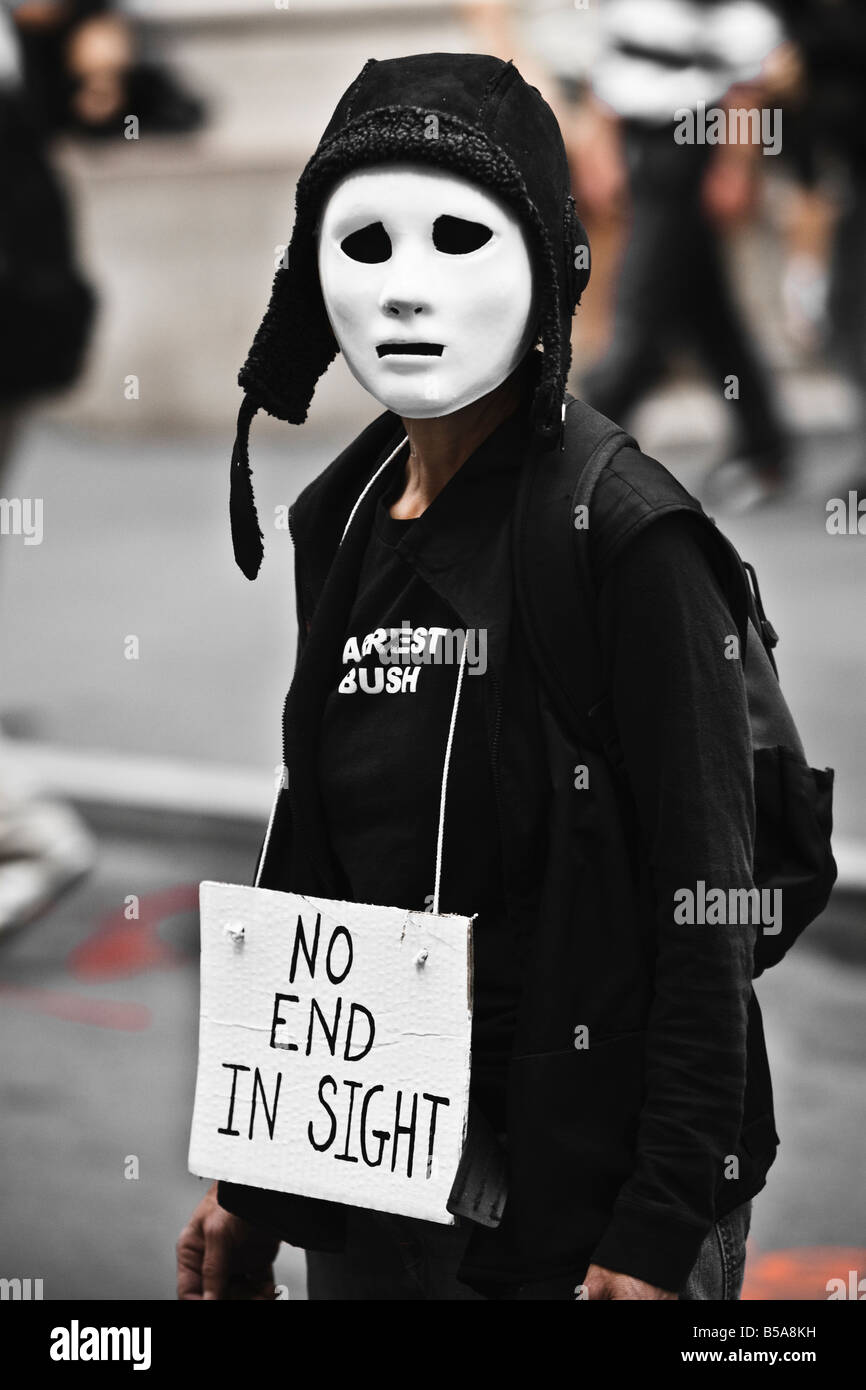 A protestor stands outside the New York Stock Exchange as the market falls hundreds of points. - Stock Image