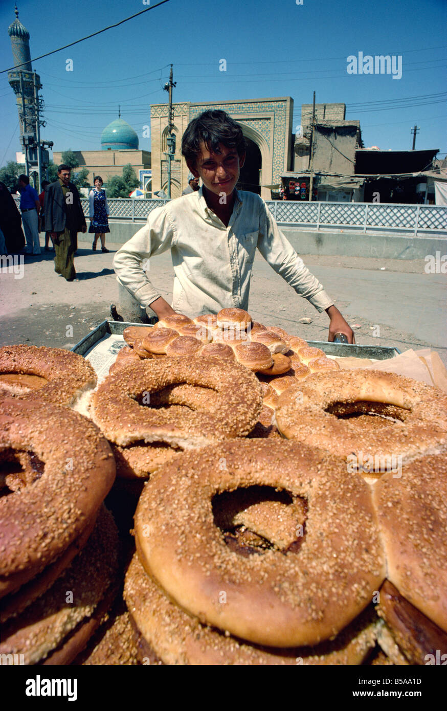 Boy selling bread taken in the 1970s Baghdad Iraq Middle East - Stock Image