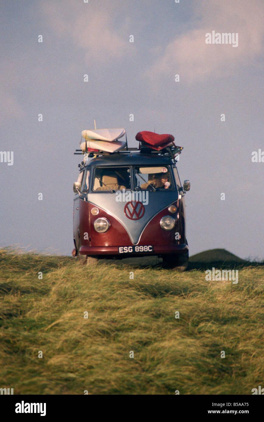 VW Camper Van with surf boards on roof D Harcourt Webster - Stock Image