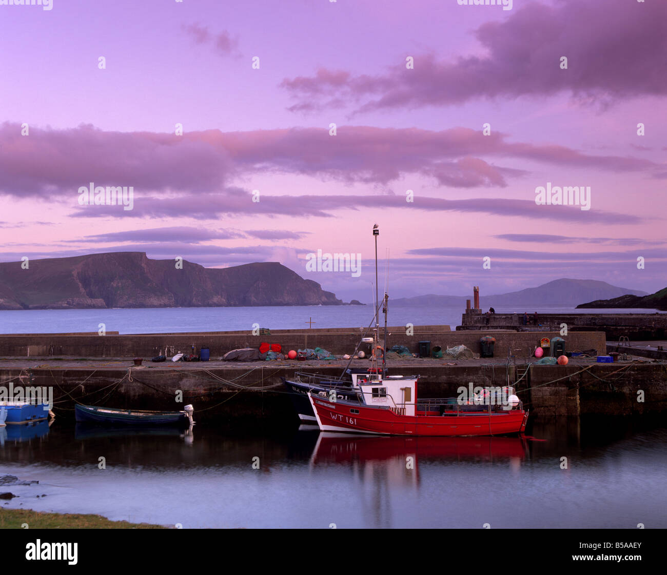 Small fishing harbour at sunset, Dooagh, Achill island, County Mayo, Connacht, Republic of Ireland, Europe - Stock Image