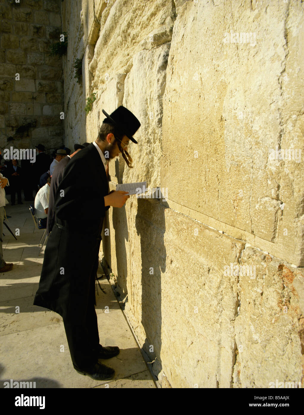 Hasidic Jew praying reciting at the Western Wall Wailing Wall Jerusalem Israel Middle East - Stock Image