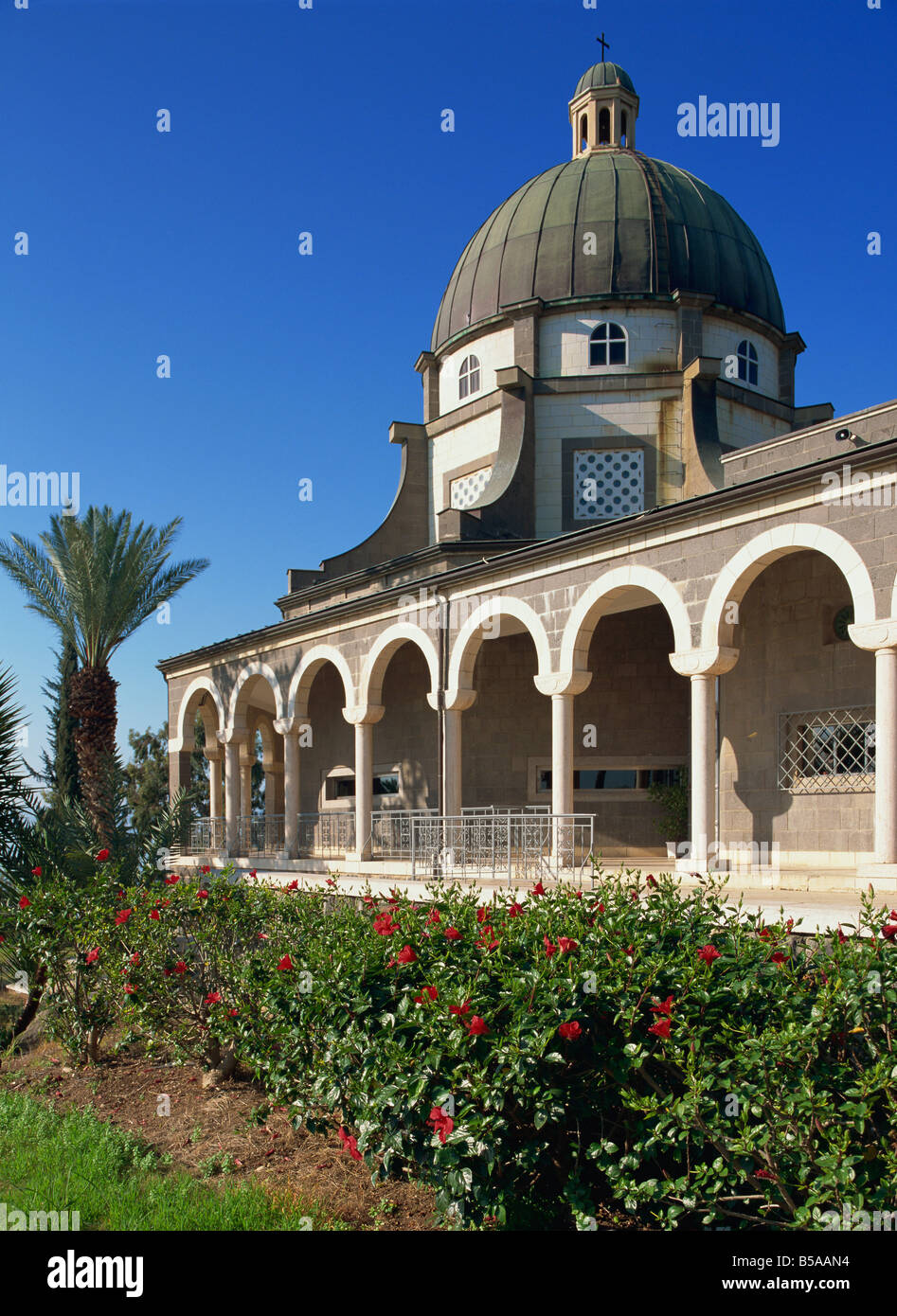 Red hibiscus in front of the Church on the Mount of Beatitudes, above the Sea of Galilee, Israel, Middle East Stock Photo
