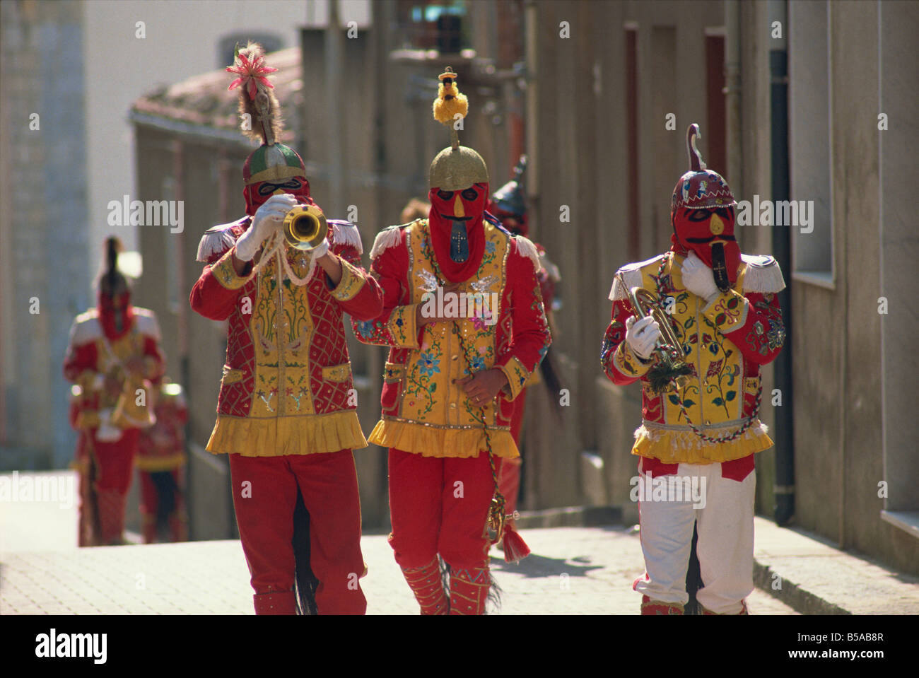 Trumpet players in red costumes and horse tails celebrate the Feast of the Jews, Sicily, Italy - Stock Image