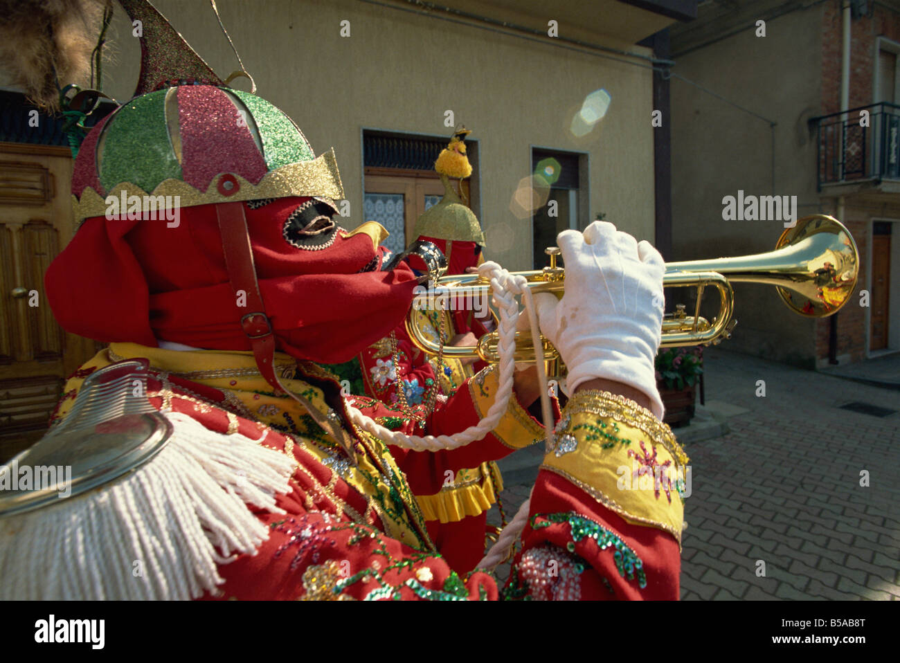 Trumpet player in red costume and mask celebrates the Feast of the Jews, in the Lombard village of San Fratello, - Stock Image