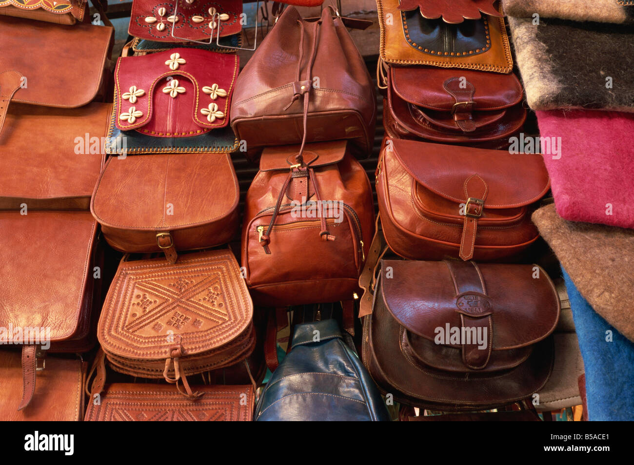 Leather goods on sale in souks Medina Marrakech Morocco North Africa Africa - Stock Image