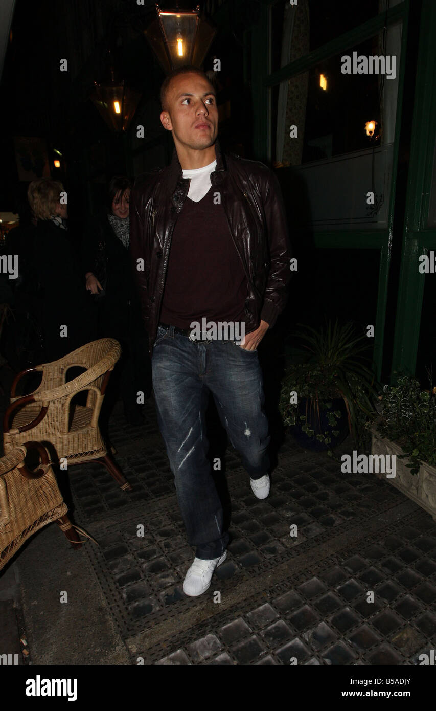 Wes Brown and the Manchester United Players leave the Old Grapes pub after hours of drinking and singing along to - Stock Image