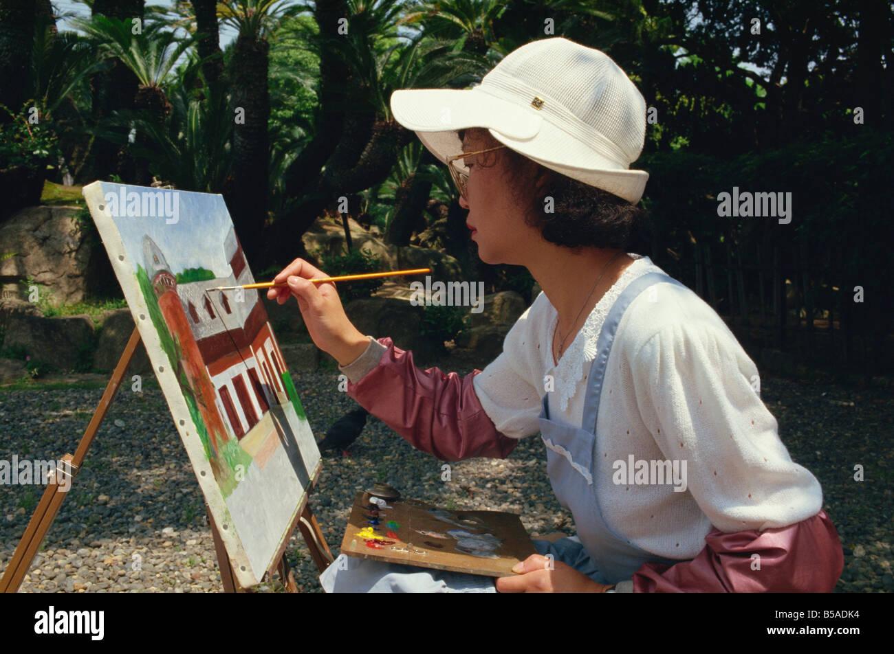 Woman painting in Sorakuen Garden Kobe Japan Asia Stock Photo