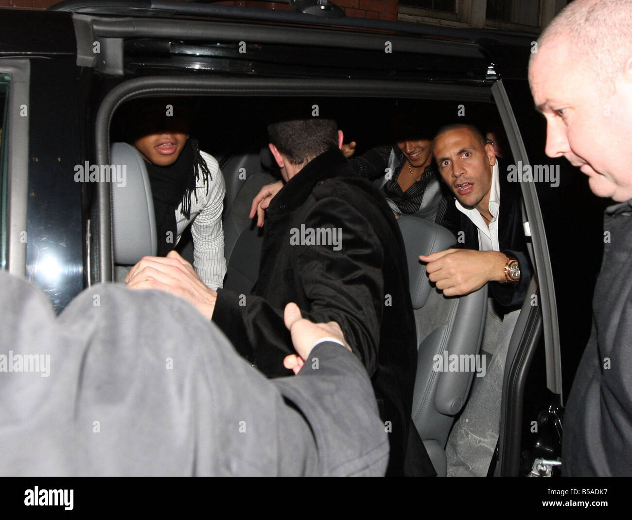 The Manchester United Players leave the Old Grapes pub after hours of drinking and singing along to the band at - Stock Image
