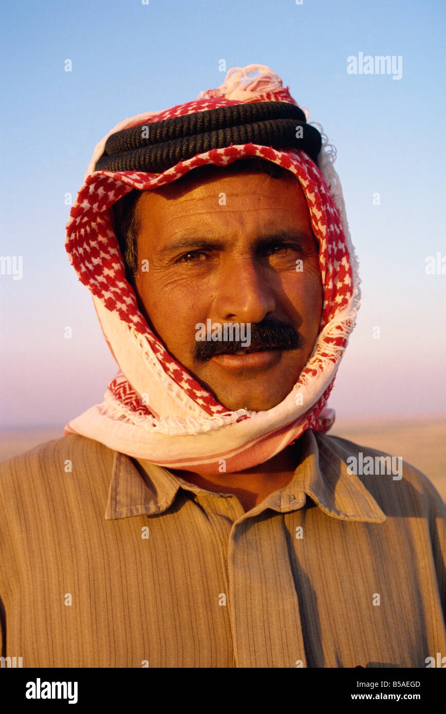 Portrait of camel driver with moustache and traditional headcloth Jordan Middle East - Stock Image