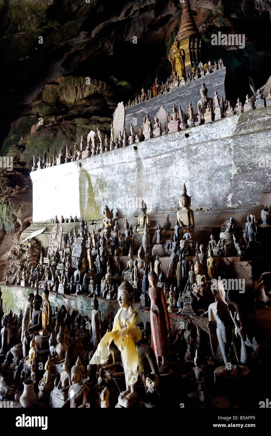 The Pak Ou caves, a well known Buddhist site and place of pilgrimage, 25km from Luang Prabang, Laos, Indochina, - Stock Image