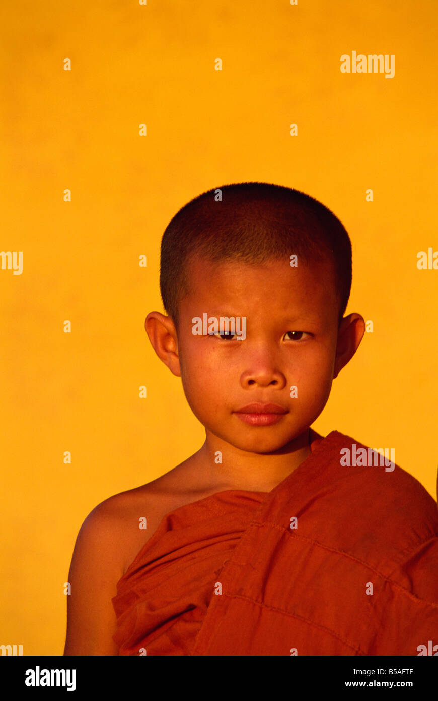 Portrait of a novice monk during Buddhist Lent in Vientiane Laos Asia A Evrard - Stock Image