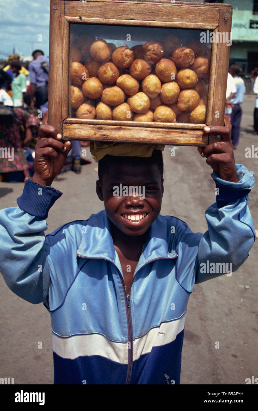 Boy selling bean cakes, Monrovia, Liberia, West Africa, Africa - Stock Image