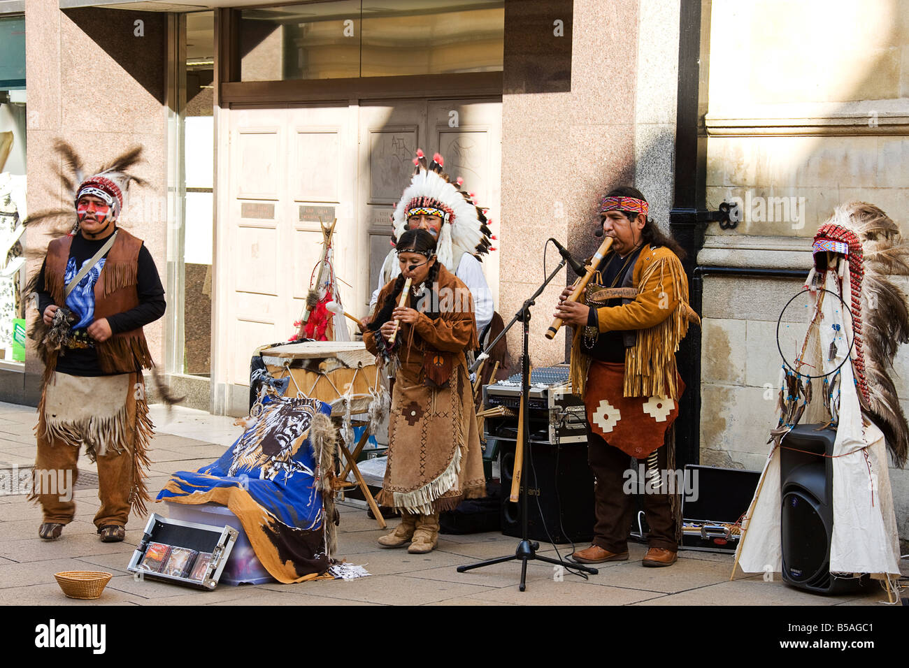 Buskers performing in the street. - Stock Image