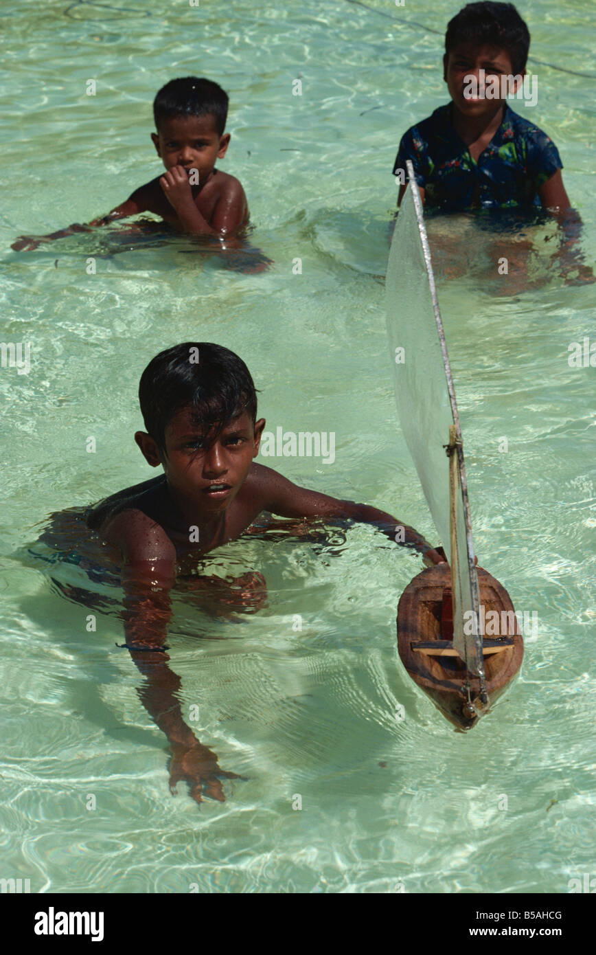 Boys with toy boat, Maldive Islands, Indian Ocean - Stock Image