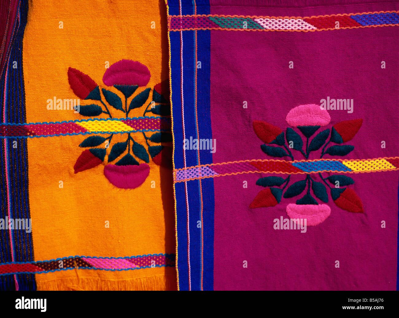 Brightly coloured craft rugs on display at San Cristobal de las Casas, in Chiapas, Mexico, North America - Stock Image