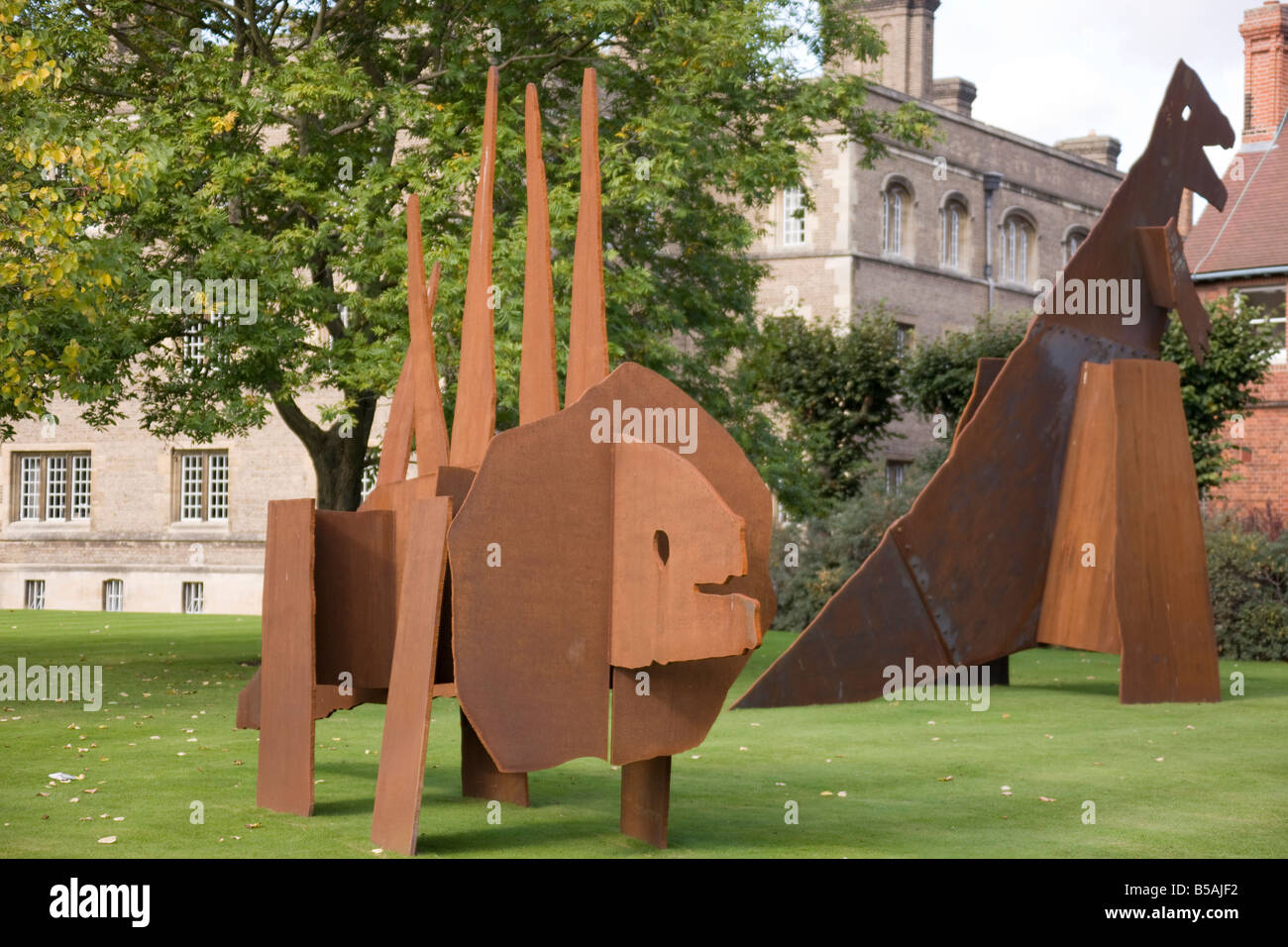 sculptures in sheet metal of two dinosaurs. - Stock Image
