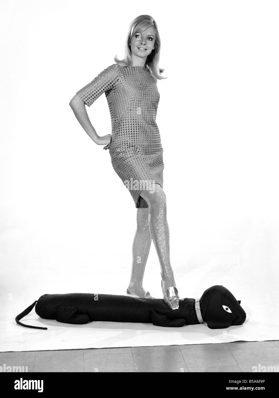 Model Anna Maria Greaves with Roly dog soft toy and draft excluder. 1959 D169-006 - Stock Image