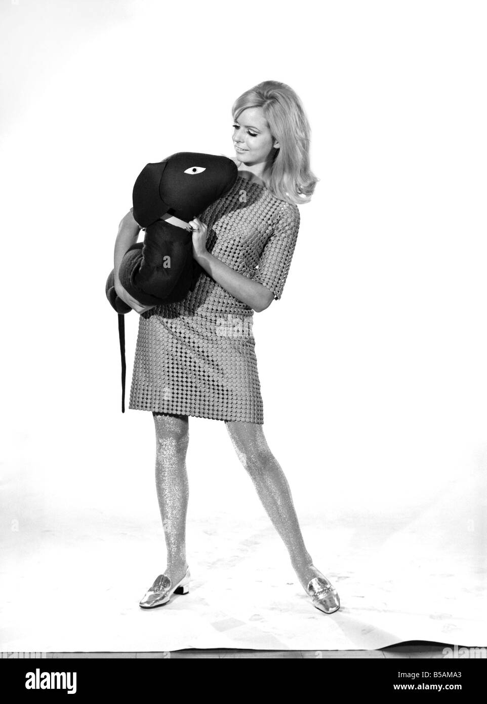 Model Anna Maria Greaves with Roly dog soft toy and draft excluder. 1959 D169-008 - Stock Image
