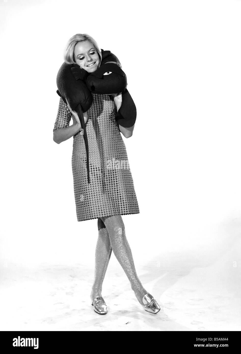 Model Anna Maria Greaves with Roly dog soft toy and draft excluder. 1959 D169-009 - Stock Image