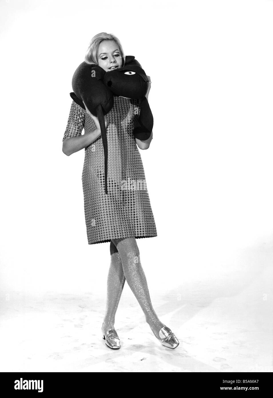 Model Anna Maria Greaves with Roly dog soft toy and draft excluder. 1959 D169-010 - Stock Image