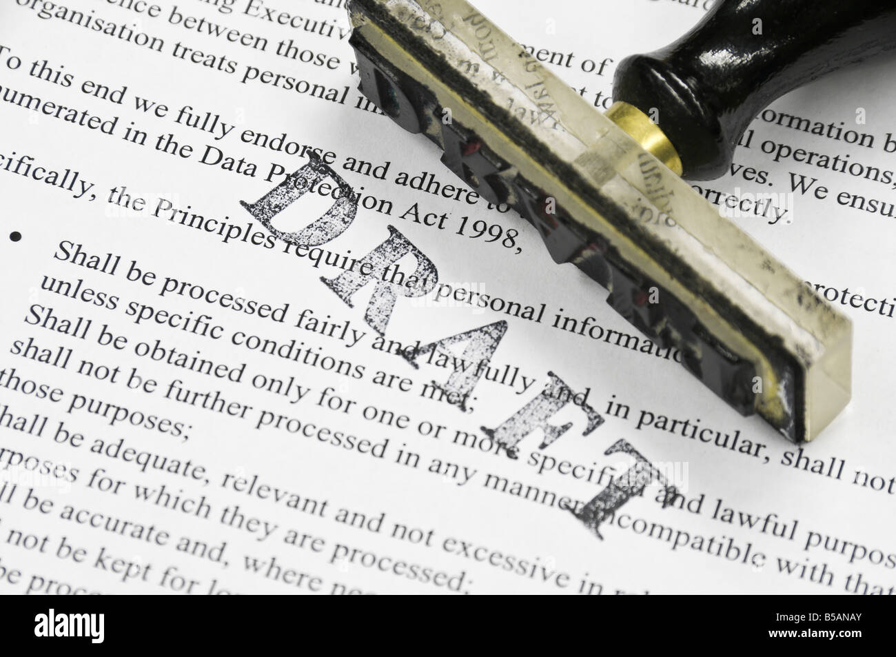 Draft stamp on a page containing Data Protection policy - Stock Image