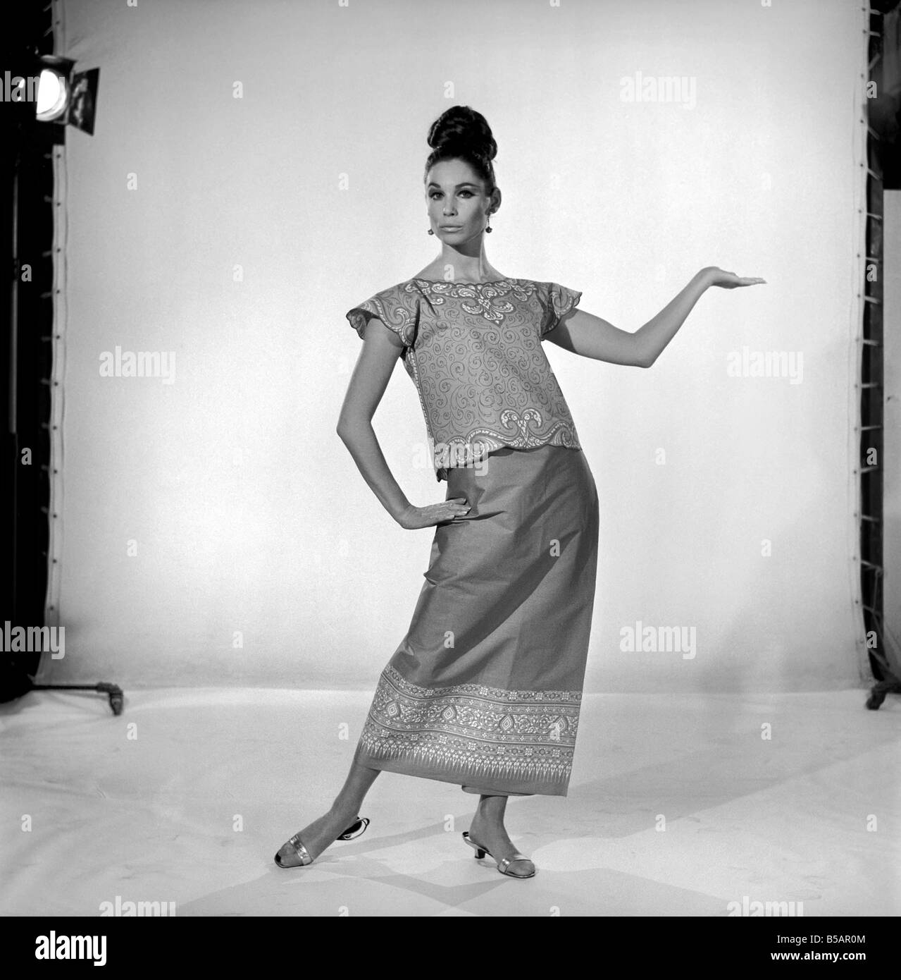 Imogen Woodford modelling a outfit with a far eastern influence. 1965 - Stock Image