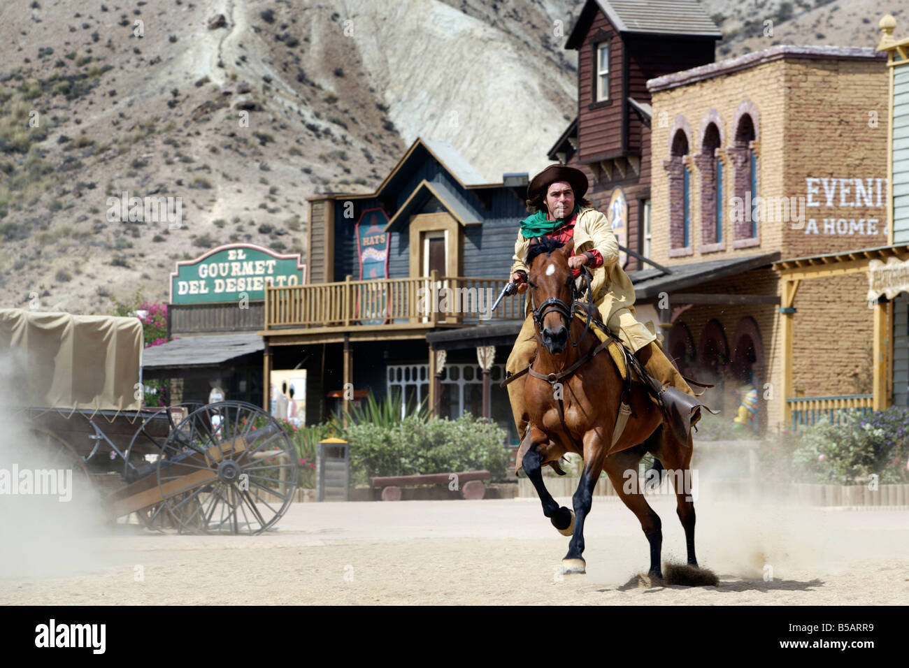 Cowboy shootout at  Spaghetti Western film set, Oasys, Mini Hollywood, Tabernas, Almeria, Spain - Stock Image