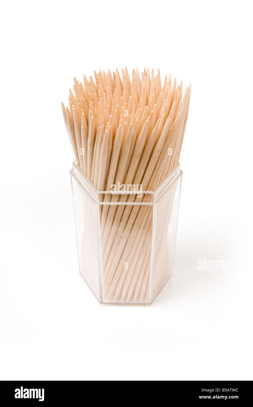 Wooden toothpicks isolated on a white studio background - Stock Image