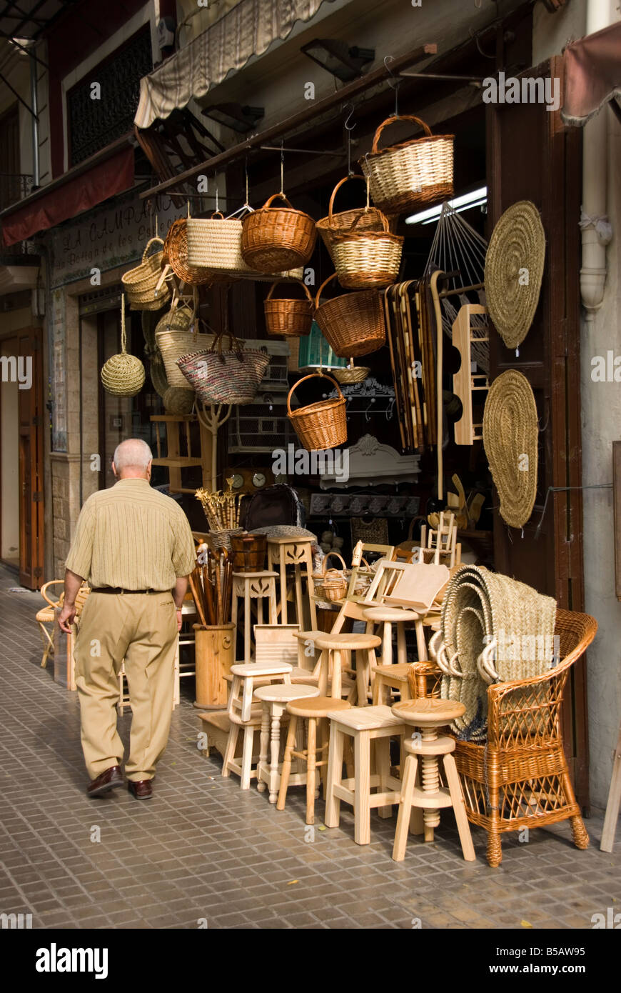 Handicraft shop selling wood furniture and wicker work in the city centre of Valencia made in the Valencian region - Stock Image