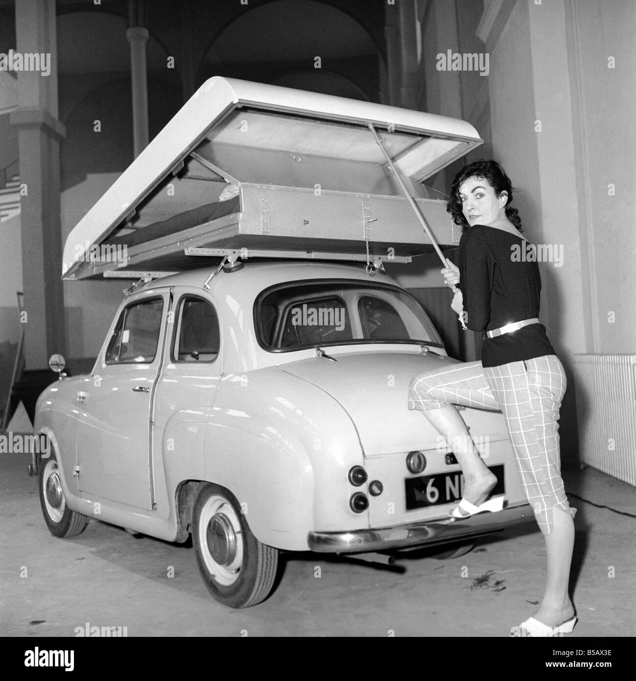 Inventions: Car Roof Tent: A new revolutionary camping invention 'The Roof Tent' seen here on top of a Austin - Stock Image