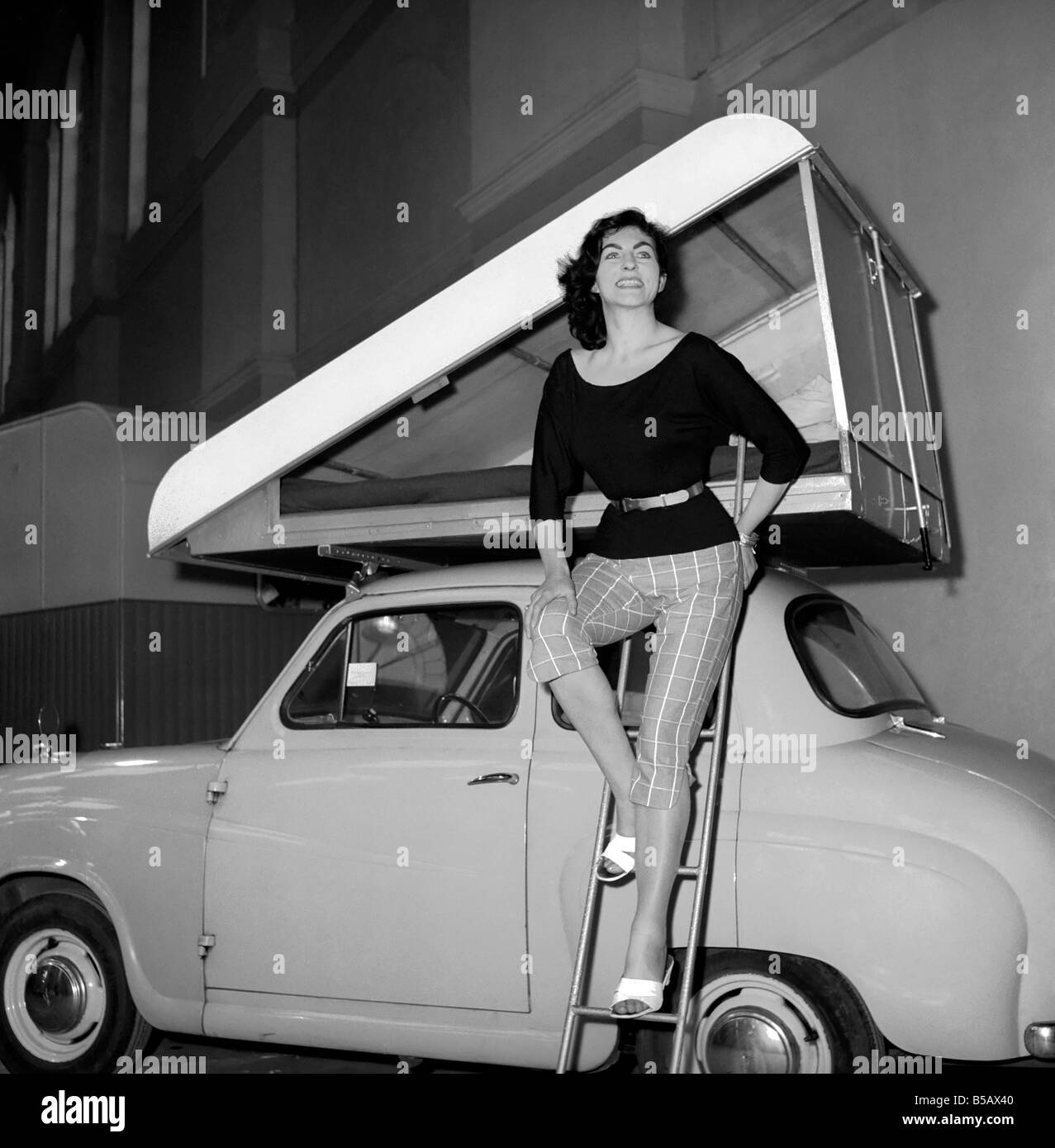 "Inventions: Car Roof Tent: A new revolutionary camping invention ""The Roof Tent"" seen here on top of a Austin A40. Stock Photo"