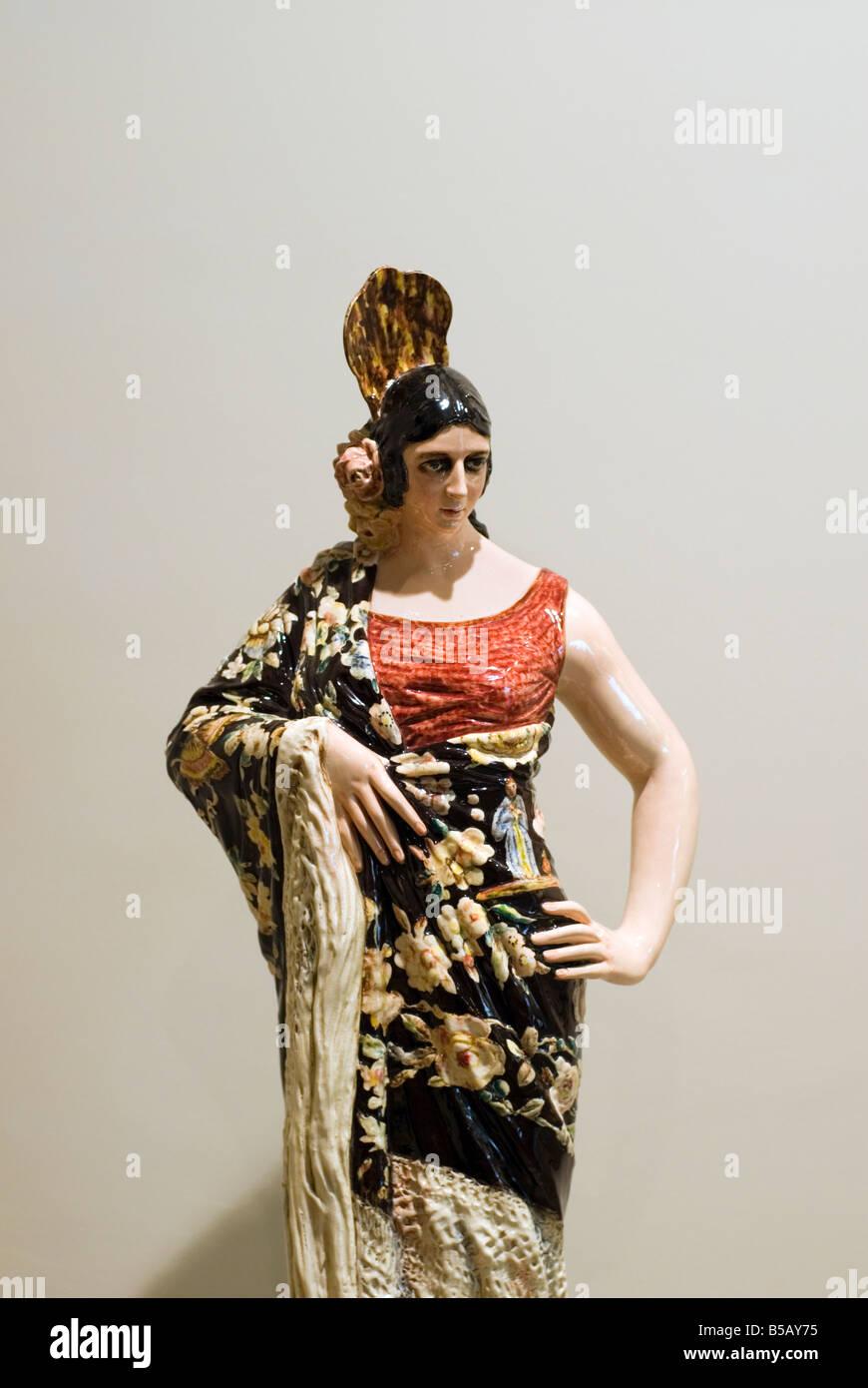 Ceramic figurine of traditionally dressed Spanish woman inside the Ceramics Museum Valencia Spain - Stock Image