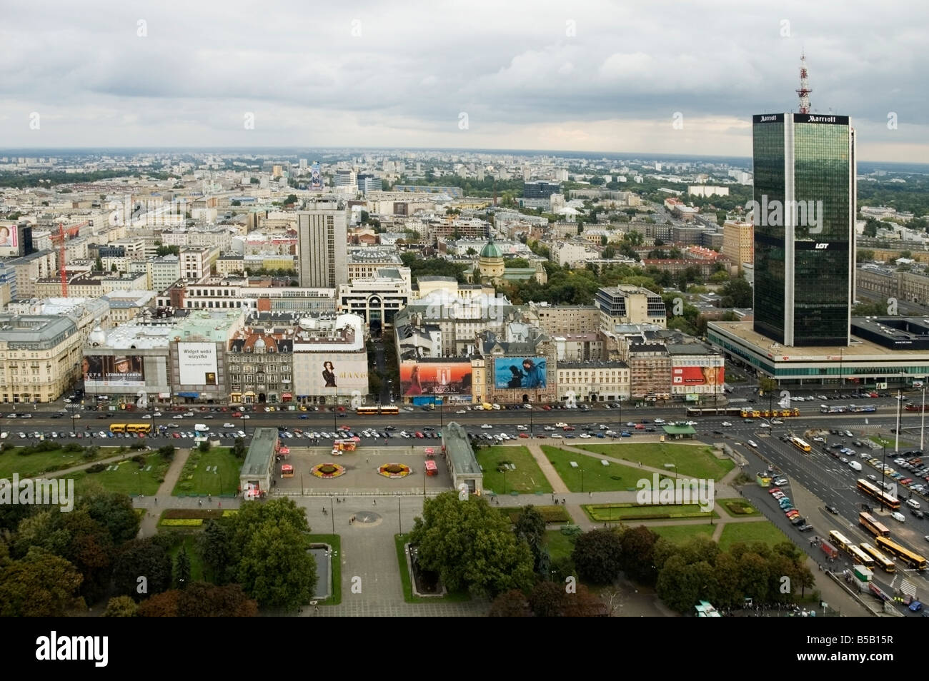 Aerial, skyline view of Central Warsaw, Śròdmieście district and Marriott Hotel 1980s skyscraper, Warszawa, - Stock Image