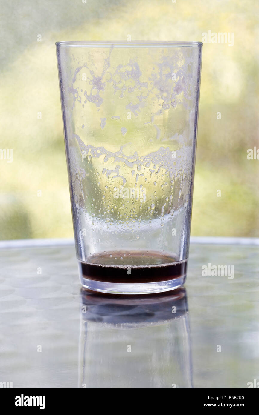 Empty glass of beer with dregs - Stock Image