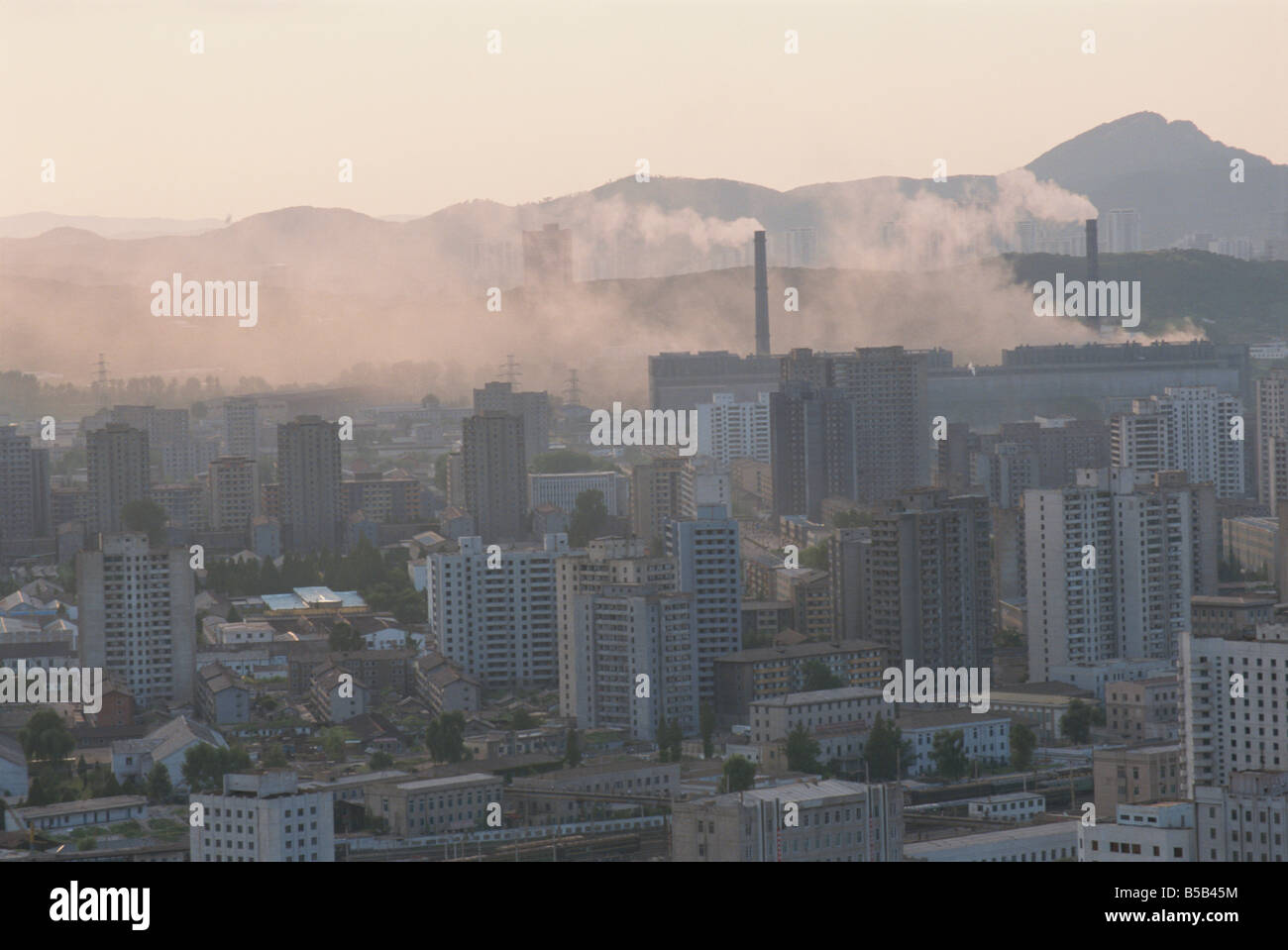City centre blocks of flats and unclean power station Pyongyang North Korea Asia - Stock Image