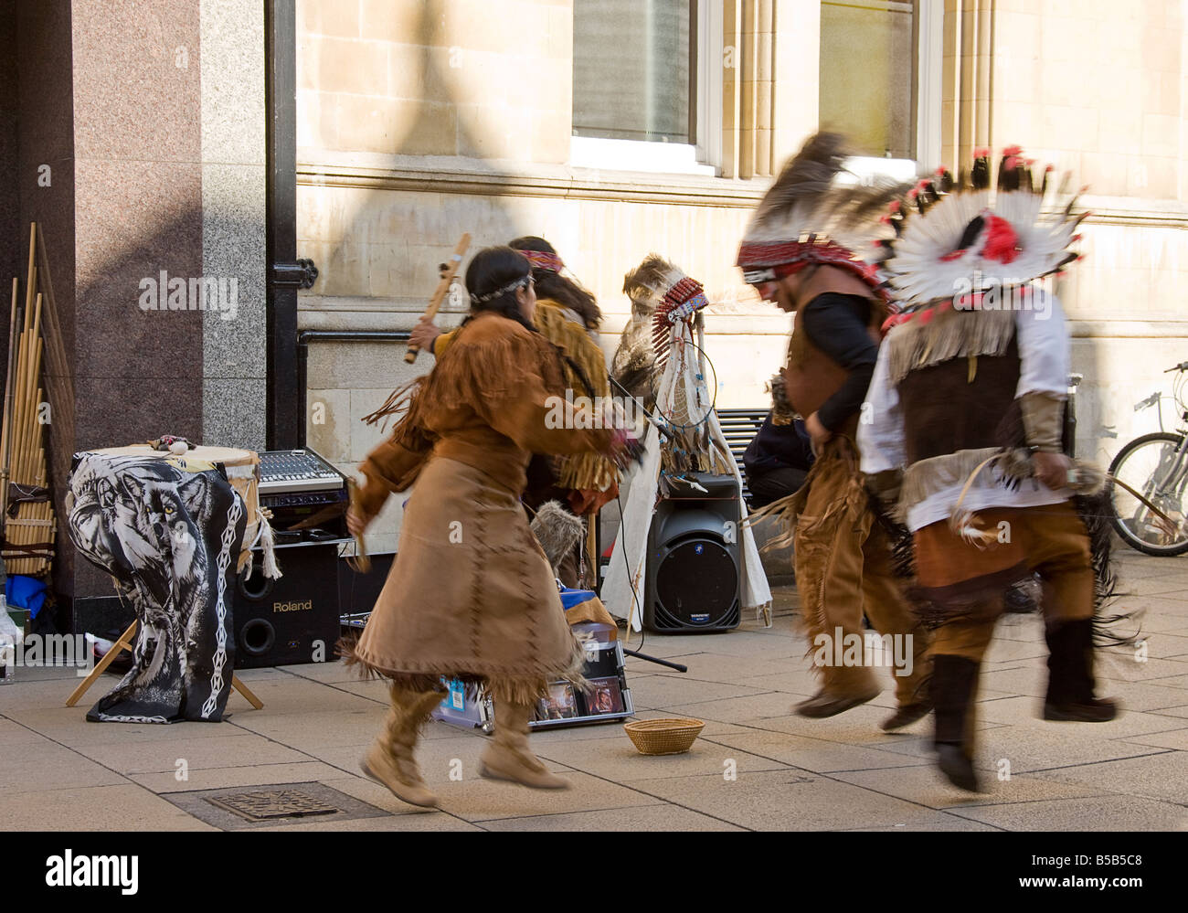 Buskers performing by dancing and singing in the street. - Stock Image