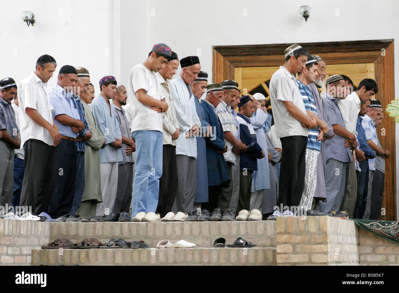 Muslim praying in the mosque, Uzbekistan - Stock Image