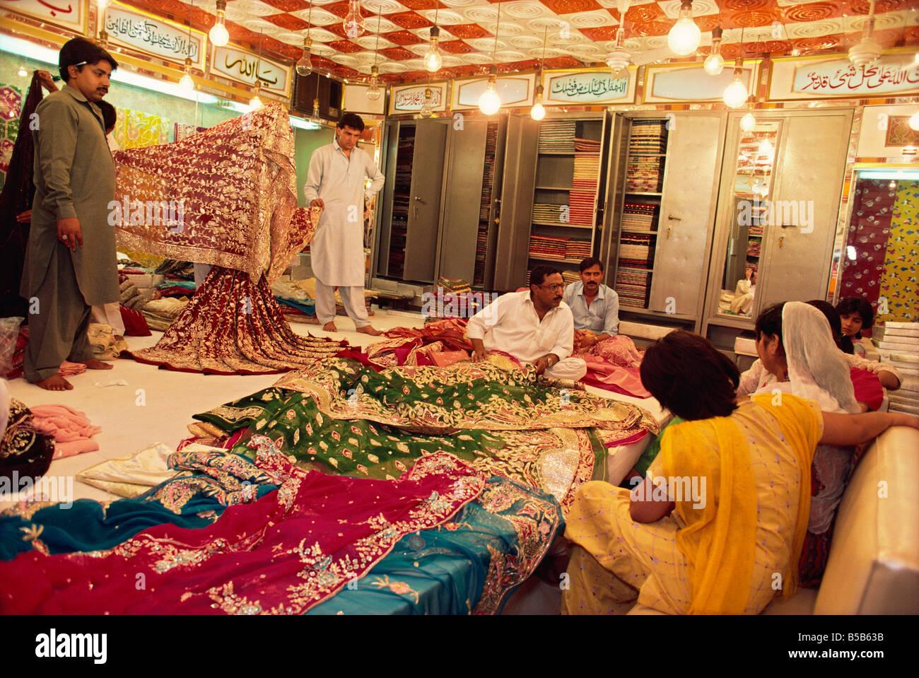Textile and silk sari shop Anarkali Bazaar Lahore Pakistan Asia - Stock Image