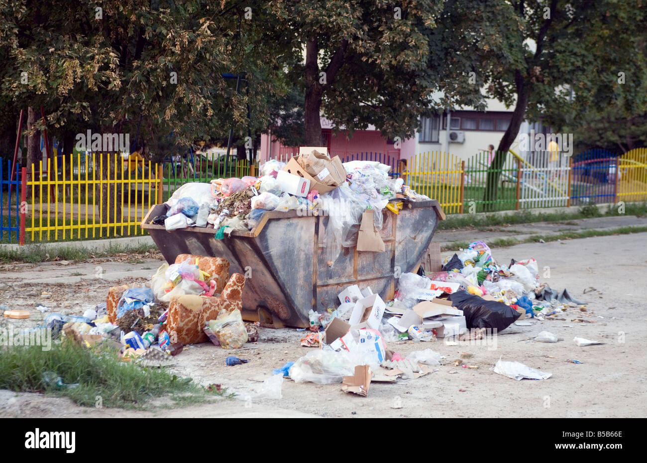 Overfilled garbage container in a back street in Banja Luka Republic of Srpska Bosnia and Herzegovina - Stock Image