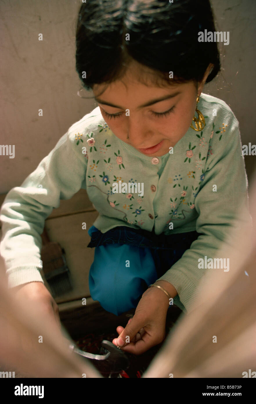 Small girl working in carpet factory in the 1970s Quetta Pakistan Asia - Stock Image