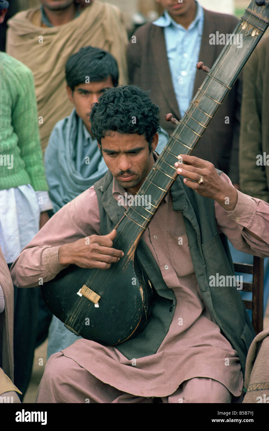 Portrait of a musician with his stringed instrument at Alipur village near Rawalpindi Pakistan Asia - Stock Image