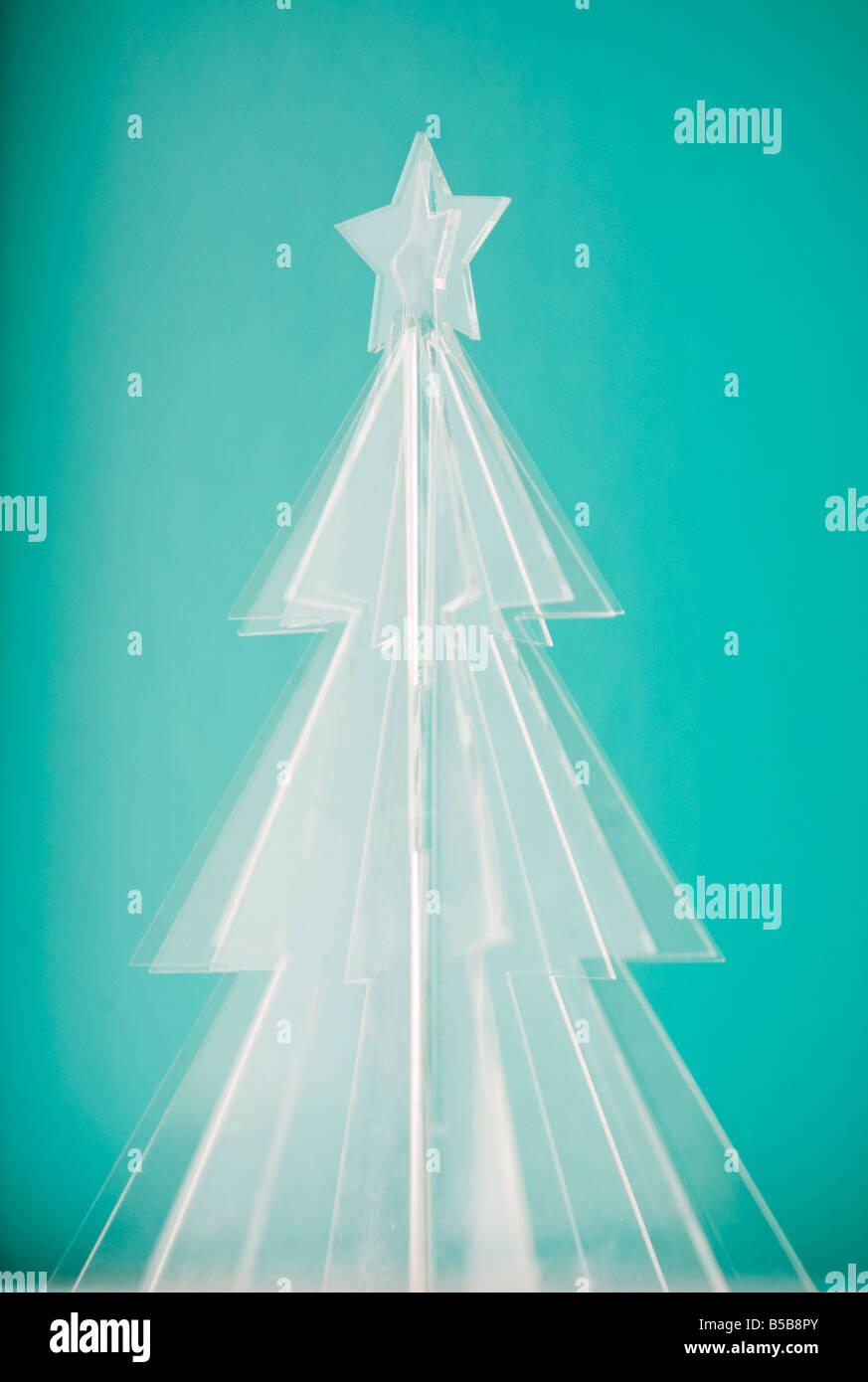 Glowing Icy Christmas Tree On Tiffany Blue Background Stock Photo Alamy