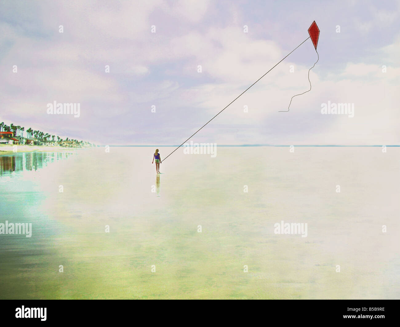 USA Photographic enhancement of a girl flying a kite at the beach - Stock Image