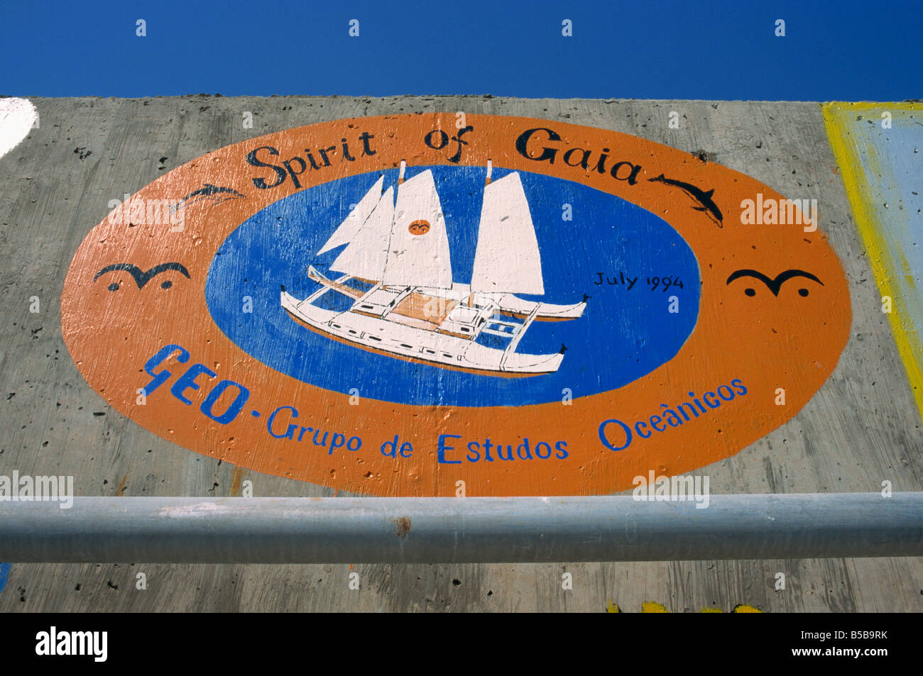 Sea wall at port decorated with pictorial souvenirs of boat s visit Porto Santo Island off Madeira Portugal Atlantic - Stock Image
