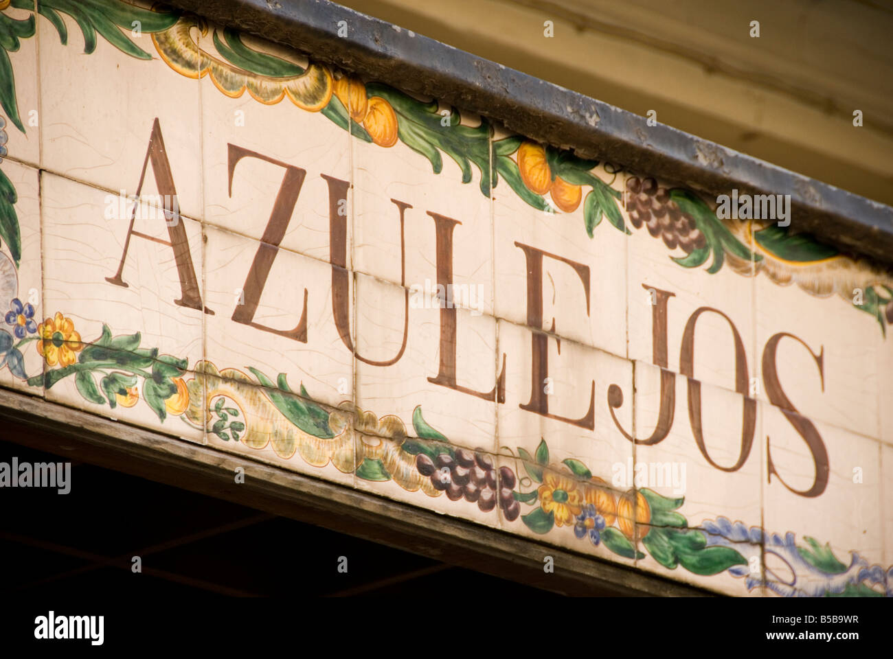 Detail of old shop sign of hand painted tiles or Azulejos in the historical city centre of Valencia Spain - Stock Image