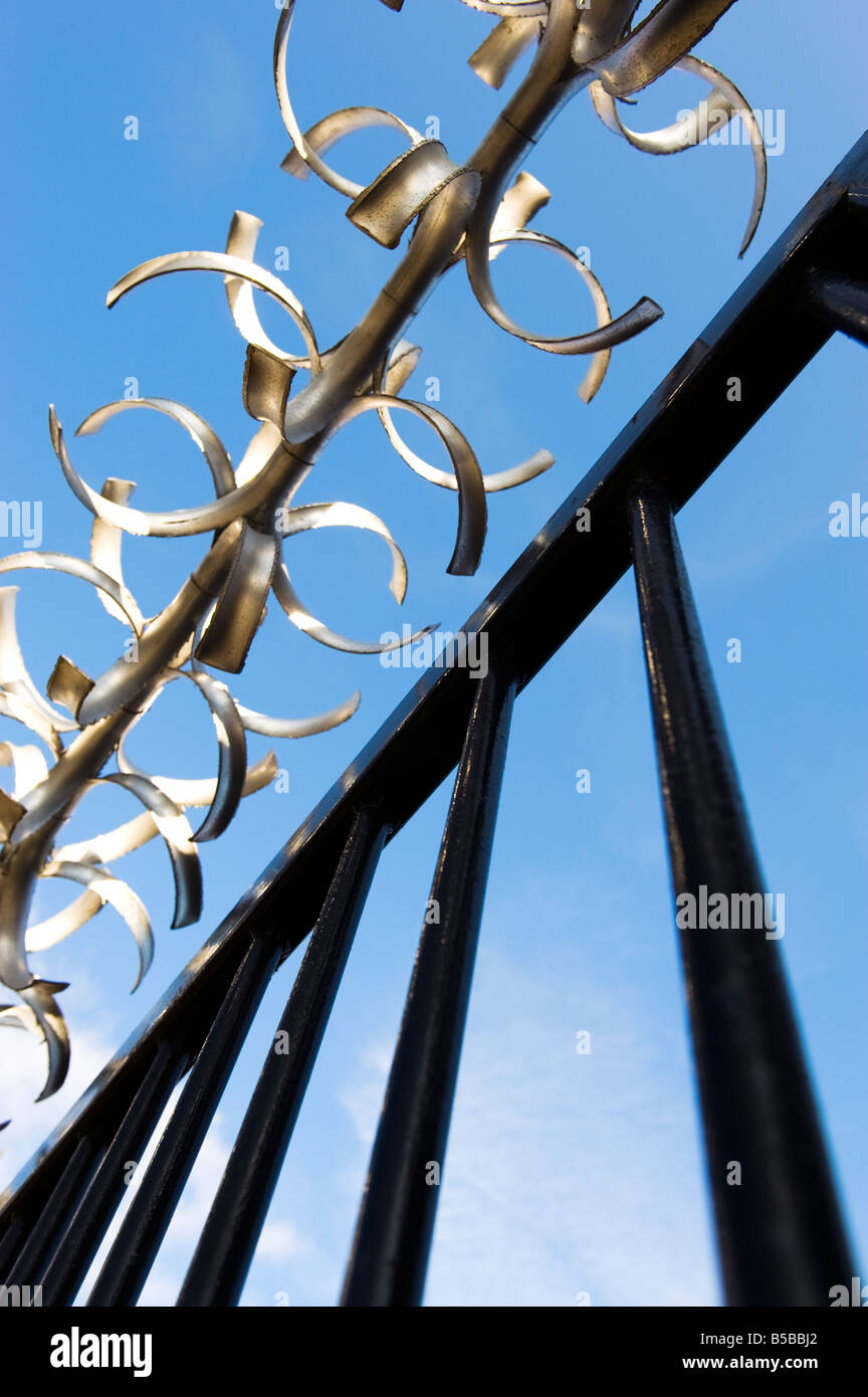 Aluminium security deterrent on the top of a black gate - Stock Image