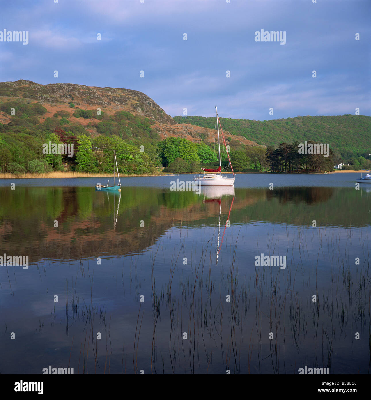 Boats and reflections, Coniston Water, Lake District National Park, Cumbria, England, Europe Stock Photo