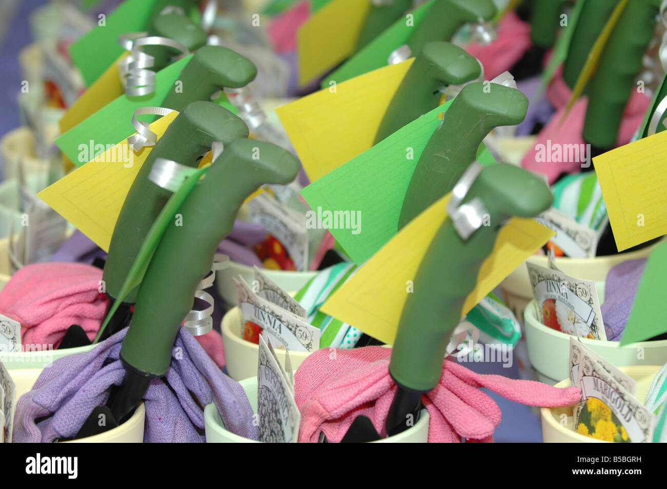 spring bridal shower party favors of gardening tools filling the frame lined up in a row