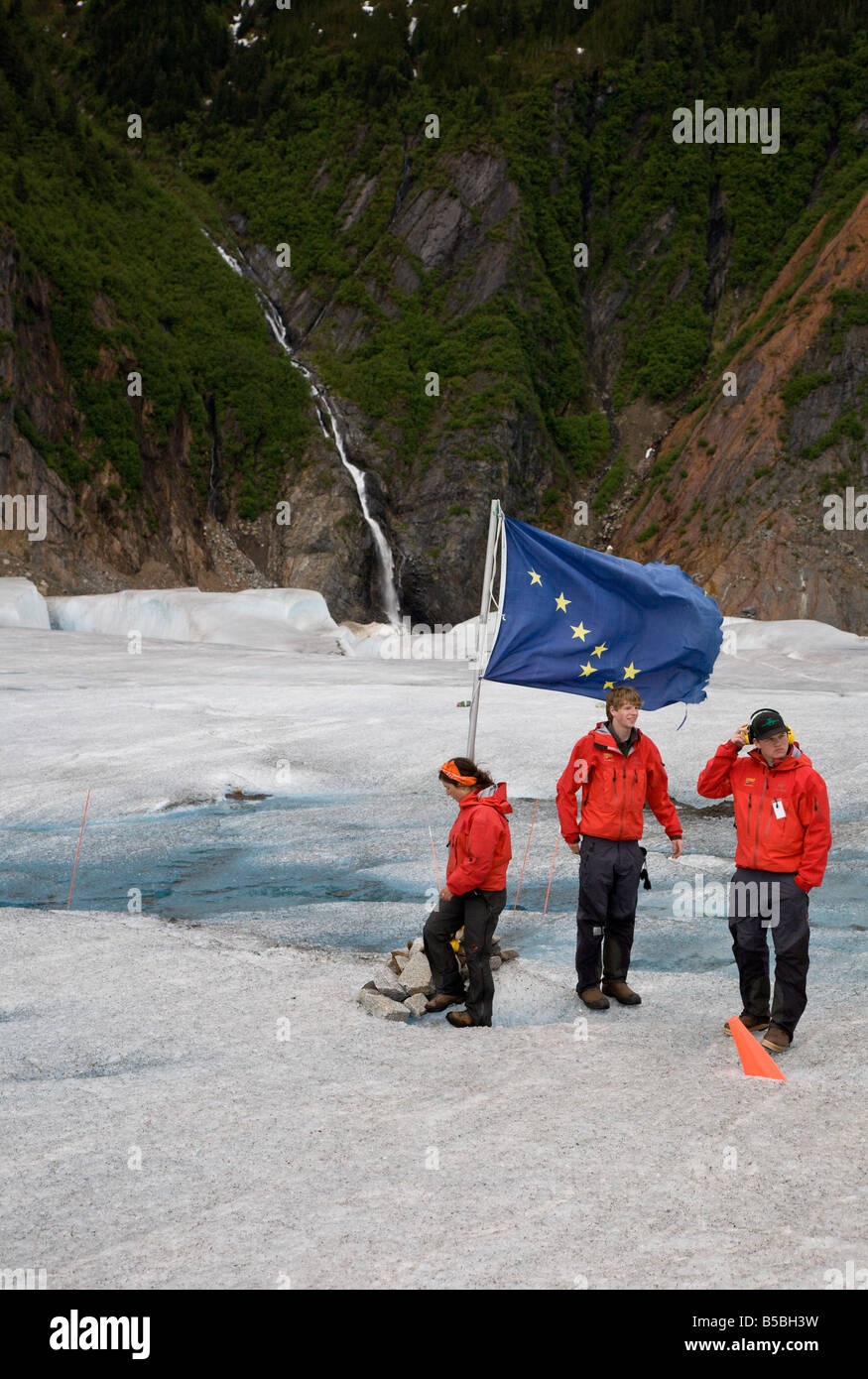 Three helicopter tour guides at base camp on Mendenhall Glacier near Juneau, Alaska - Stock Image
