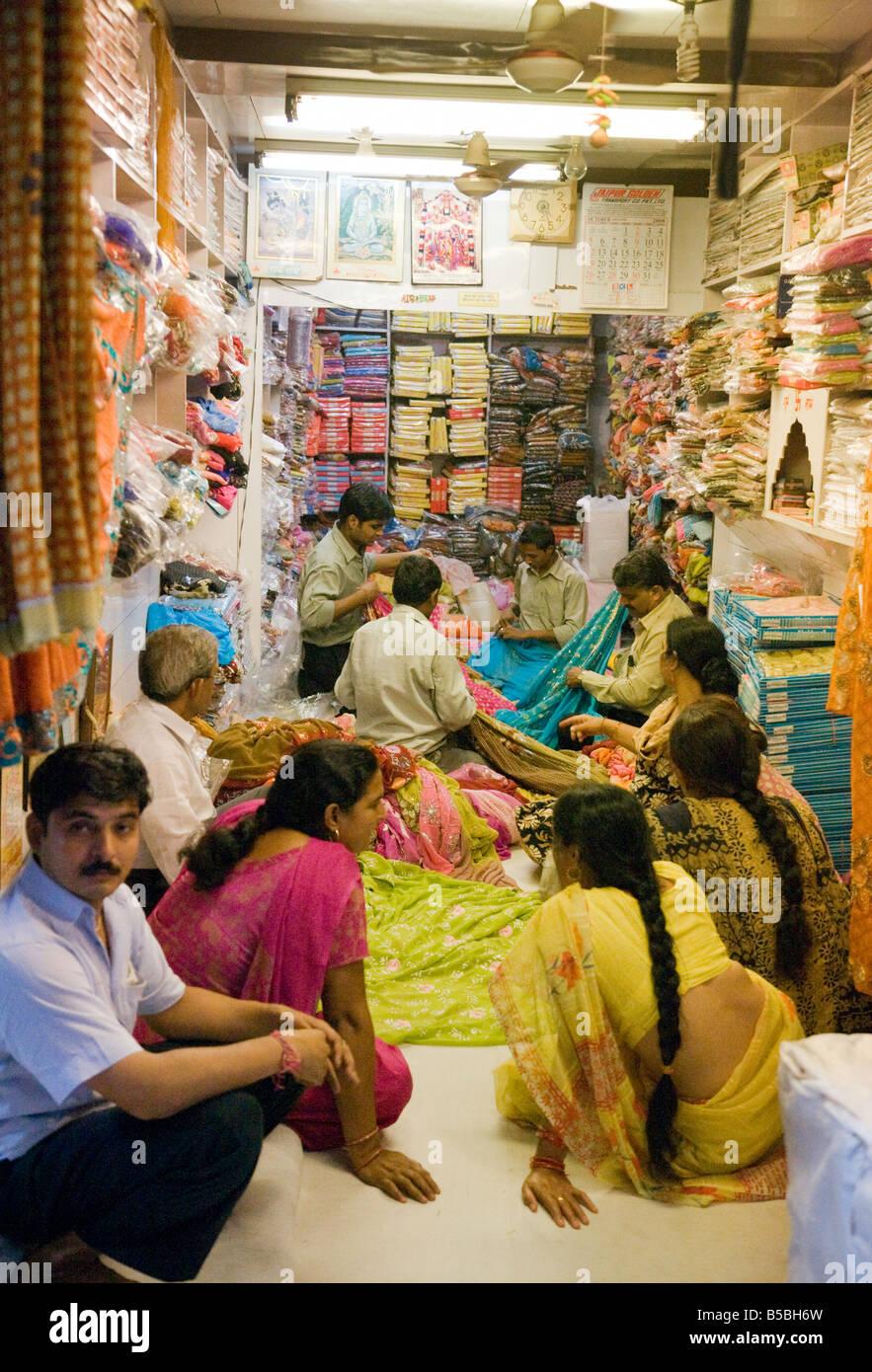 3a8e54f627 Women shopping and buying saris in a sari shop in the Kinari market, Old  Delhi India